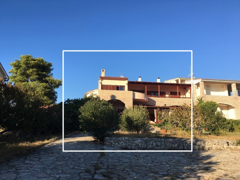 The semi-detached house is the house in the white frame in the Sibenik region - house for sale Croatia.