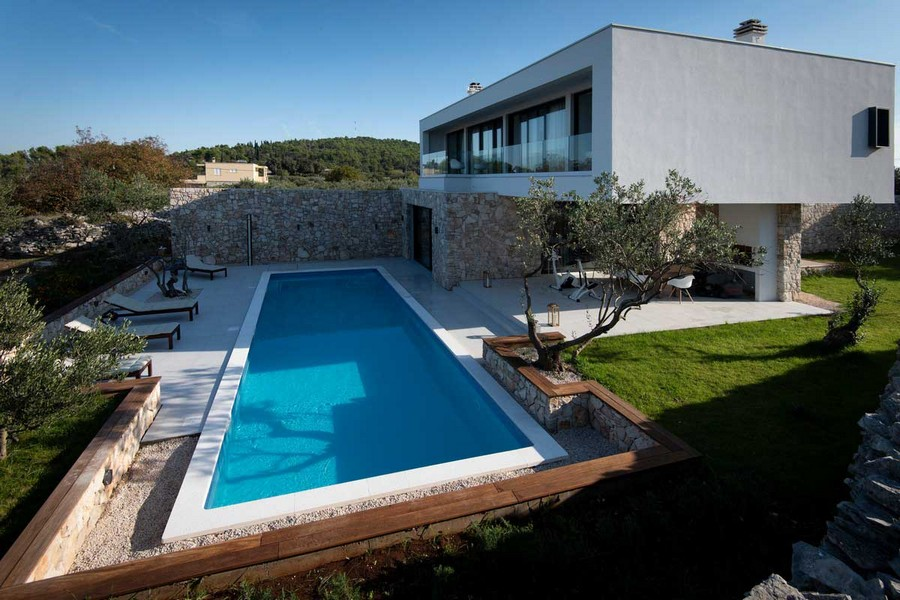 View of the swimming pool and the side of the villa - buy a house in Croatia.