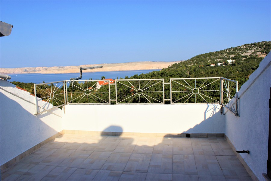 View of the roof terrace with a view of the surroundings and the sea - buy a house in Croatia.