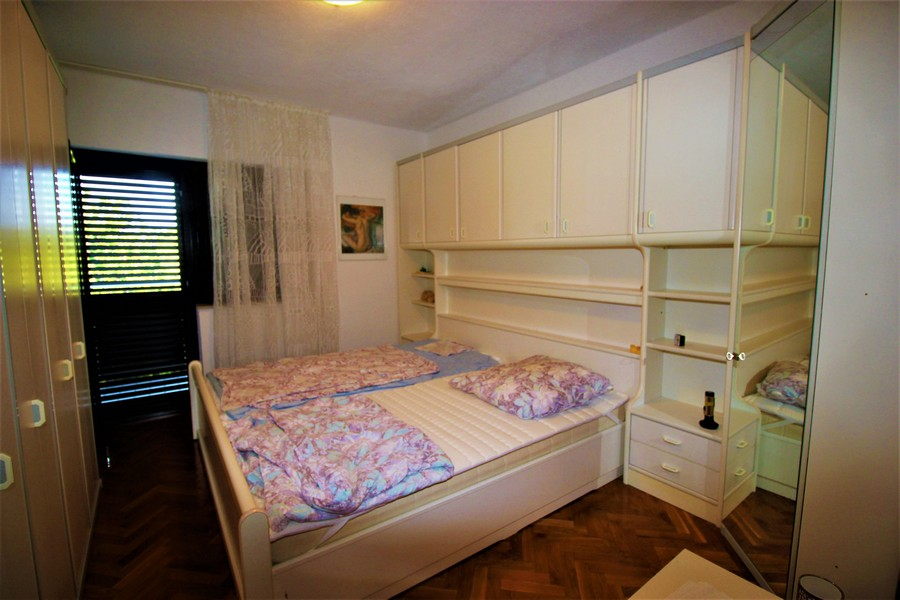 Another bedroom in the family house with double bed and exit to the balcony - Buy a house in Croatia.