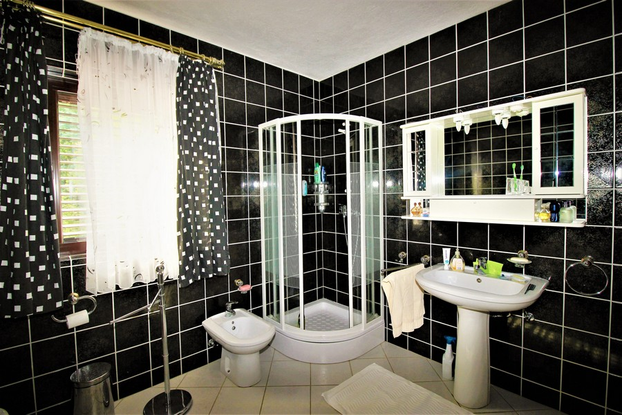 A bathroom of the property H1562 with shower, bidet and window - Buy a family house Croatia.