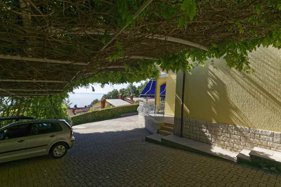 Shady outdoor spaces are part of the apartment hotel in Lovran, Croatia.