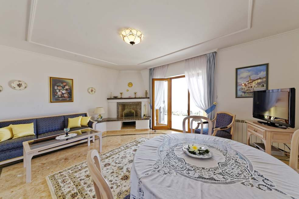 One of the luxurious living-dining areas in the apartment hotel in Lovran, which is offered for sale
