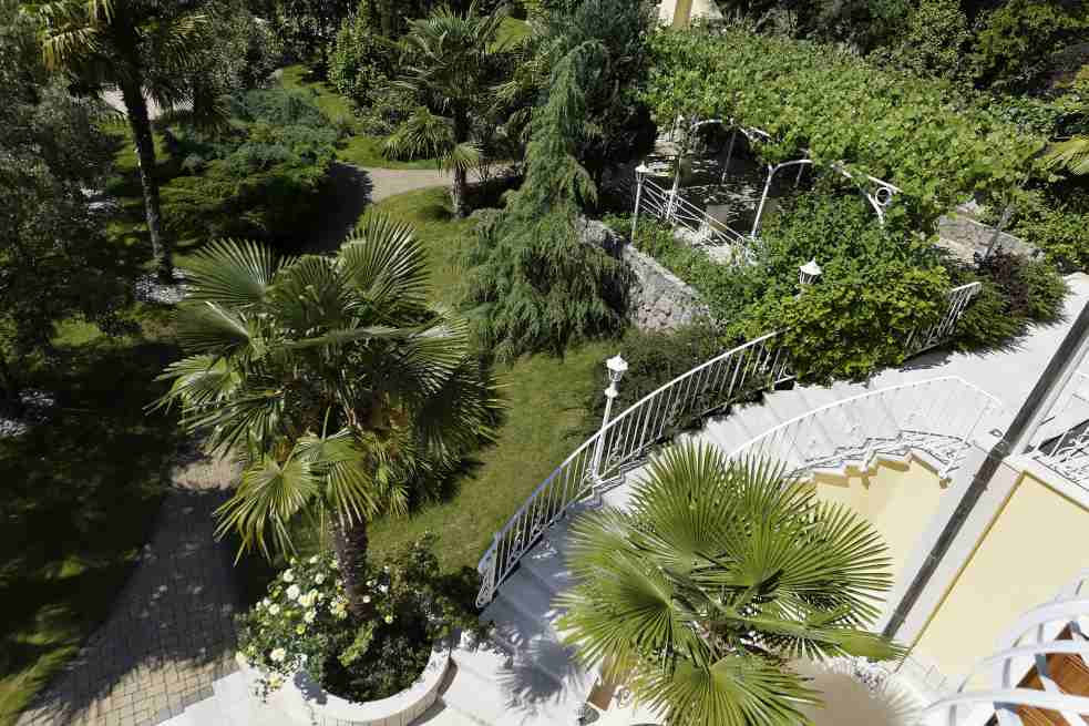View into the tropical garden of the apartment hotel in Croatia, which is to buy
