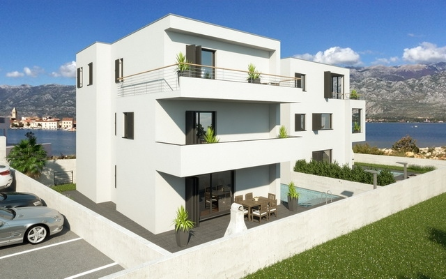 Here is the overall view of the building with the new seafront apartments with pool for sale in Croatia - Panorama Scouting