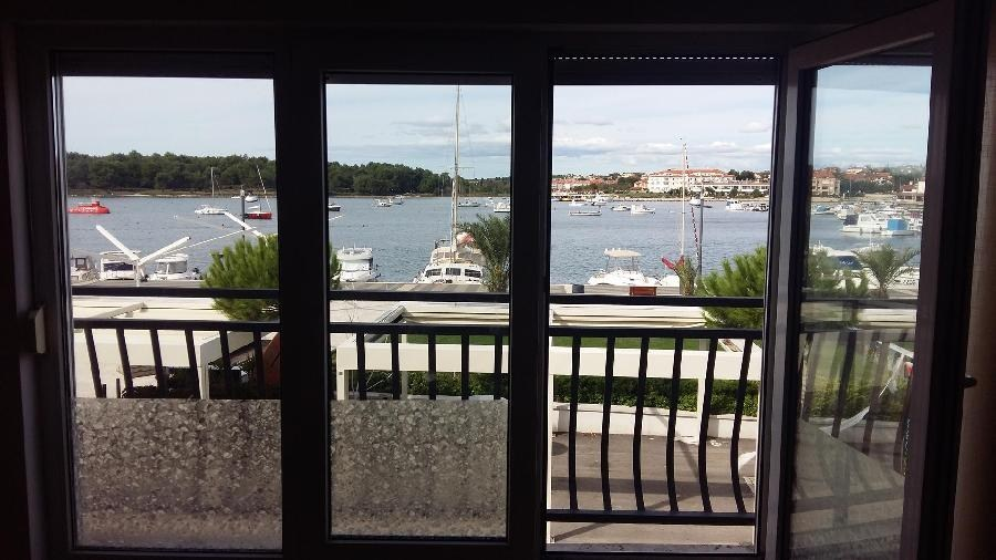 From the apartments for sale in Istria there is a beautiful view of the promenade and the Marina
