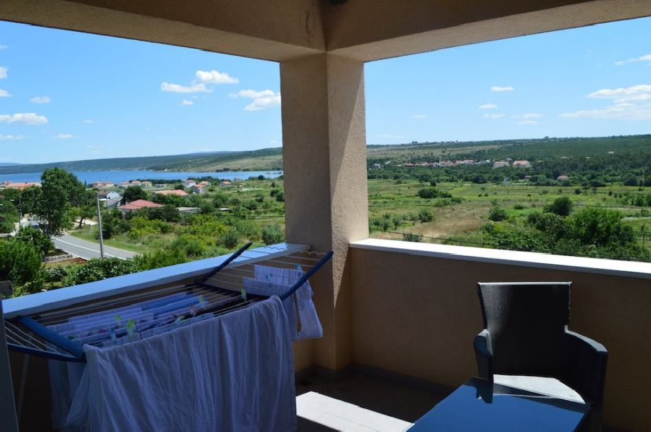 Covered terrace with sea view - apartment for sale in Croatia.